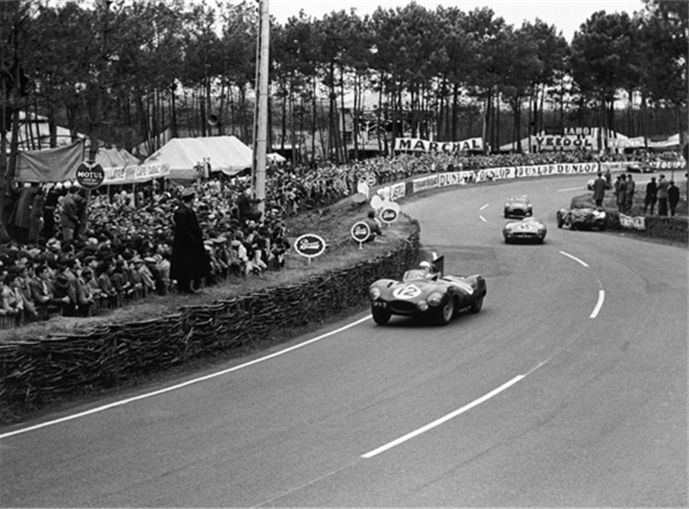 Le Mans, France. 12th - 13th June 1954. Stirling Moss behind the wheel of Jaguar D-Type, XKD 403