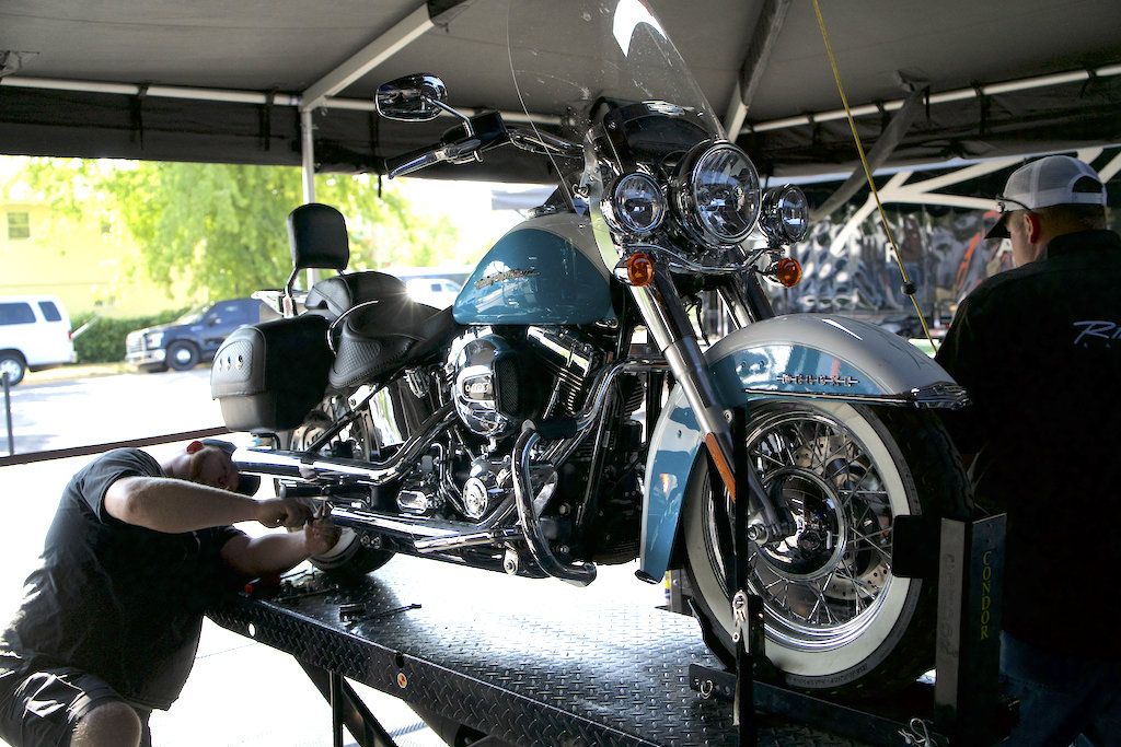 Rinehart Racing staff installing customer exhaust systems at the Sturgis Motorcycle Rally.