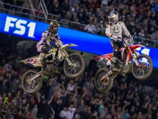 Jason Anderson (21) and Ken Roczen (94) battle for the 450SX Main Event win at the Oakland Monster Energy Supercross