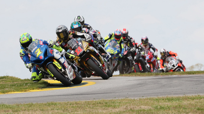 Toni Elias (1) leads Mathew Scholtz (11), Cameron Beaubier (hidden) and the rest of the Motul Superbike pack on Saturday at Road Atlanta on the opening lap