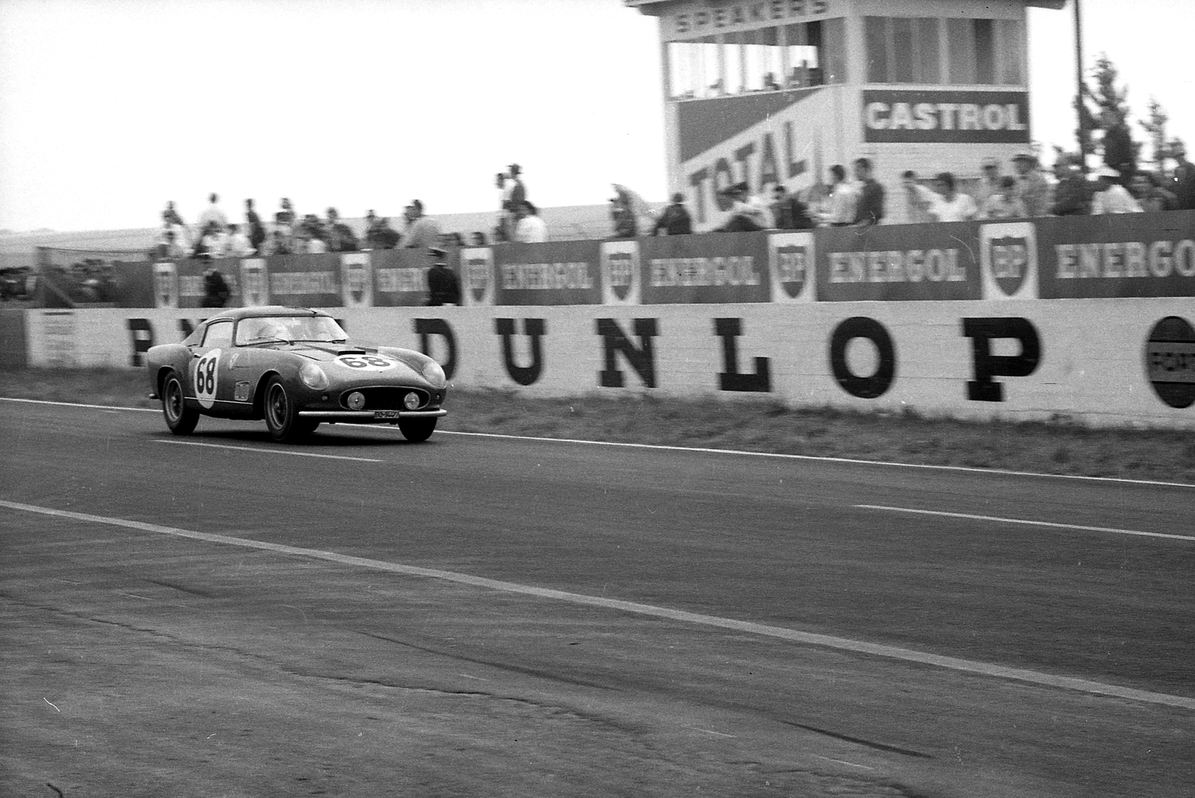 RM Sotheby's - Period image 2 (racing) Wolfgang Seidel behind the wheel of 0879 GT at the 1958 12 Hours of Reims. Courtesy of The GP Library