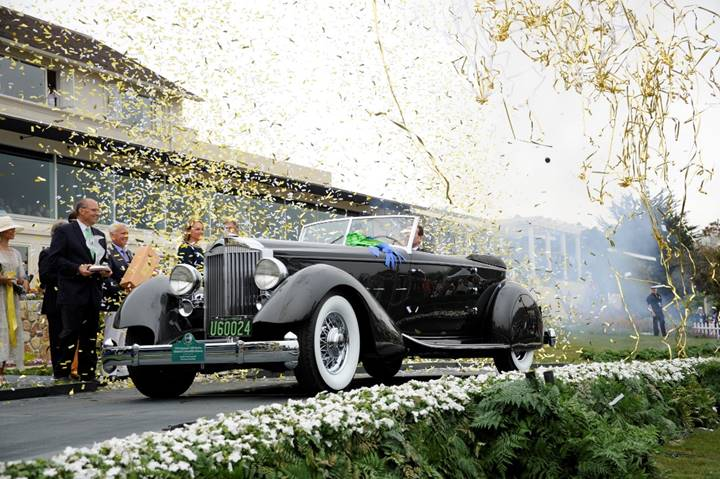 1934 Packard Twelve Individual Custom Convertible Victoria wins Best of Show at the 2013 Pebble Beach Concours d'Elegance (Credit – Eugene Robertson © 2013 Courtesy of RM Sotheby's).