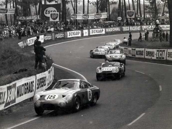 Phil Hill leading the NART Ferrari 330 TRI/LM on the opening lap of the 1963 24 Hours of Le Mans (Credit - Courtesy of LAT Images).