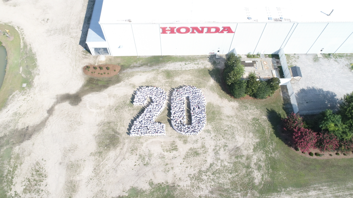 Honda of South Carolina associates celebrate 20 years of production.