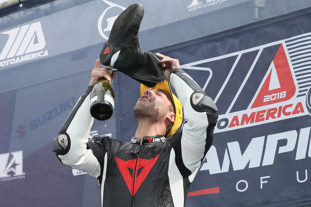 Chad Lewin won his first-career MotoAmerica race in his first-career MotoAmerica start when he won the Stock 1000 class. He celebrated, Aussie style, by drinking champagne from his boot. | Photo by Brian J. Nelson