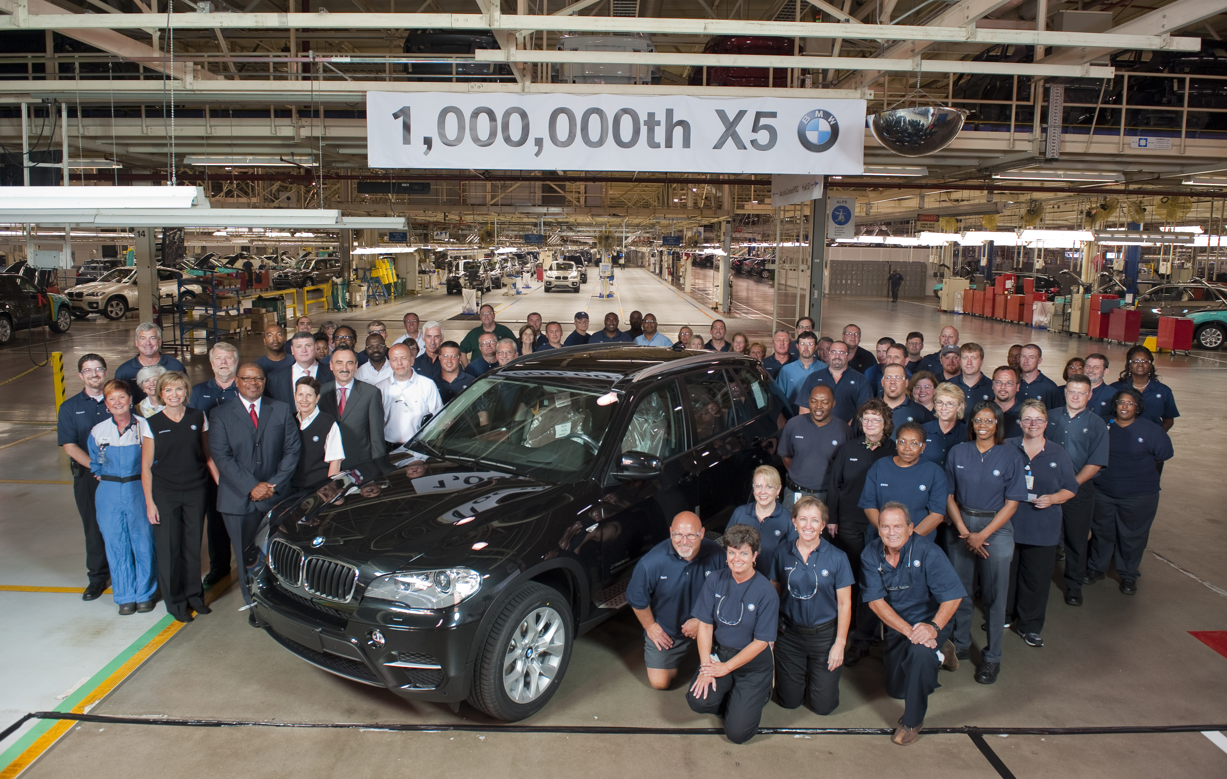 BMW Associates gather around the 1 millionth BMW X5. The vehicle rolled off the Assembly Line at BMW's Spartanburg Factory on June 8, 2010. (06/2010)
