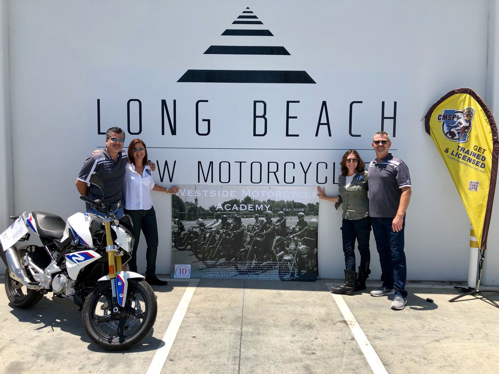 Long Beach BMW Motorcycles co-owners Charles Berthon and David Lindahl with Westside Motorcycle Academy co-owners Erika Willhite and Amanda Cunningham.