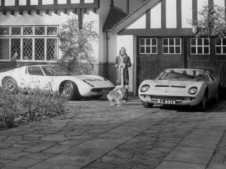 Rod Stewart's girlfriend poses with his Lamborghini Miuras outside his home in Southgate in 1970 - RM Sothebys London Auction