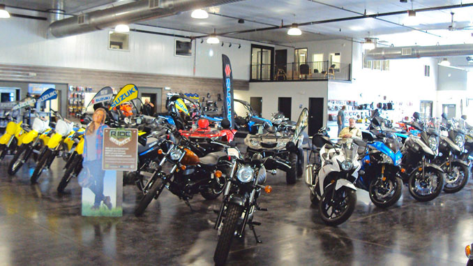 Demo Ride - Suzuki motorcycle on display in Rice's Rushmore Motorsports new showroom. Photo by Terry Hoyt.
