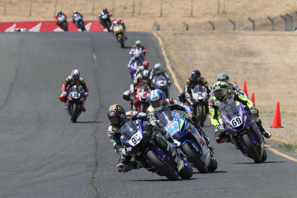 JD Beach (95) battled Valentin Debise (53) and Hayden Gillim (69) in the second Supersport race on Sunday at Sonoma Raceway before pulling away to victory. | Photo by Brian J. Nelson