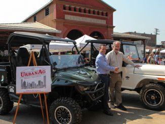 left to right; Richard Ansell, VP of Marketing, Mahindra Automotive North America and Dan Carmody, President, Eastern Market Corporation