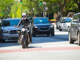 Labor Day weekend - motorcyclist in traffic (credit- Jeff Kardas)