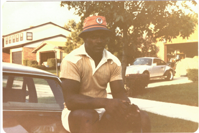 Chicago Bears' Walter Payton with his 930 Turbo parked in the background