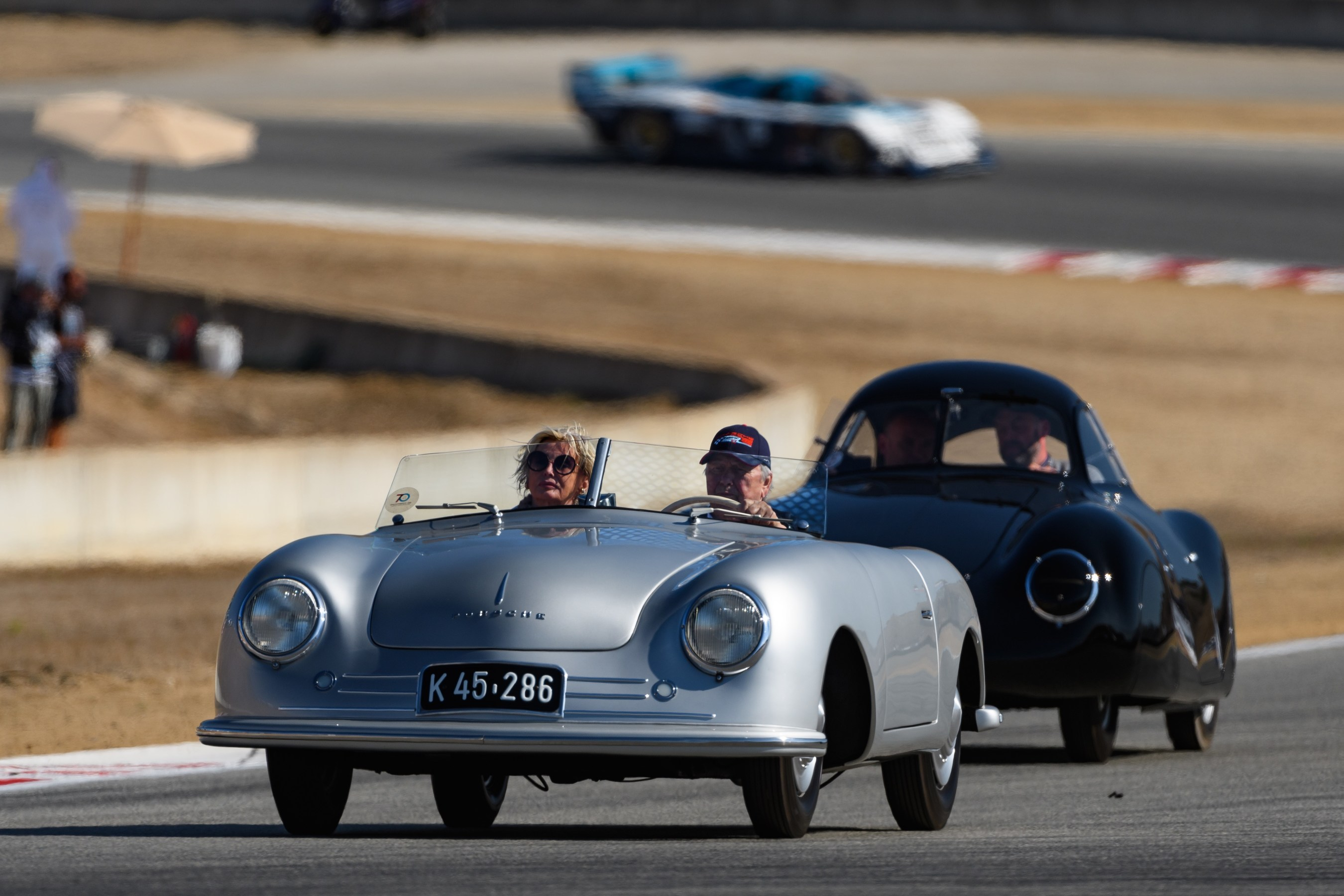 "Dr. Wolfgang Porsche driving the original 356 ""No. 1"" Roadster at Rennsport Reunion VI."