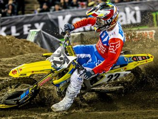 Chad Reed (#22) explodes out of a sandy whoops section on his Suzuki RM-Z450 - Oakland Supercross