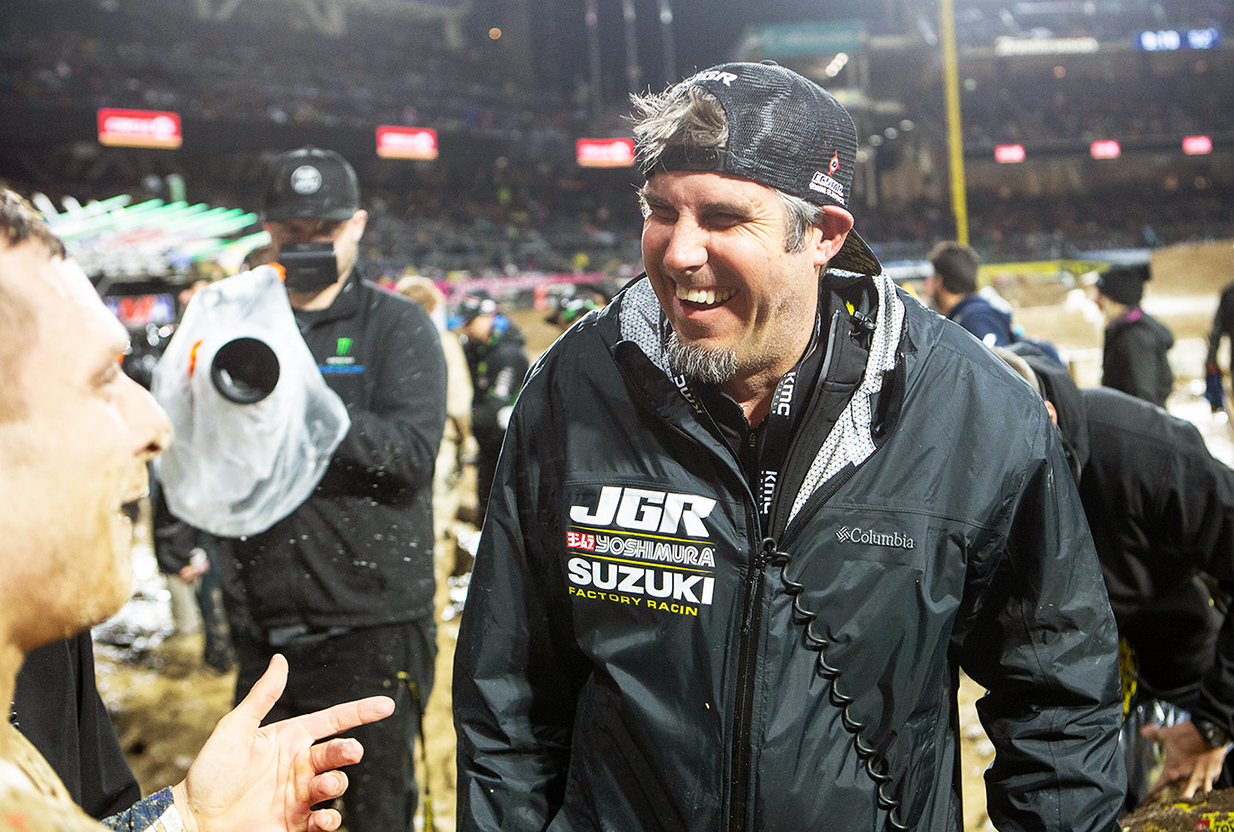 Team Manager Jeremy Albrecht (R) enjoys the post race euphoria following Jimmy Decotis' (L) podium finish in the 250 West main event - San Diego Supercross