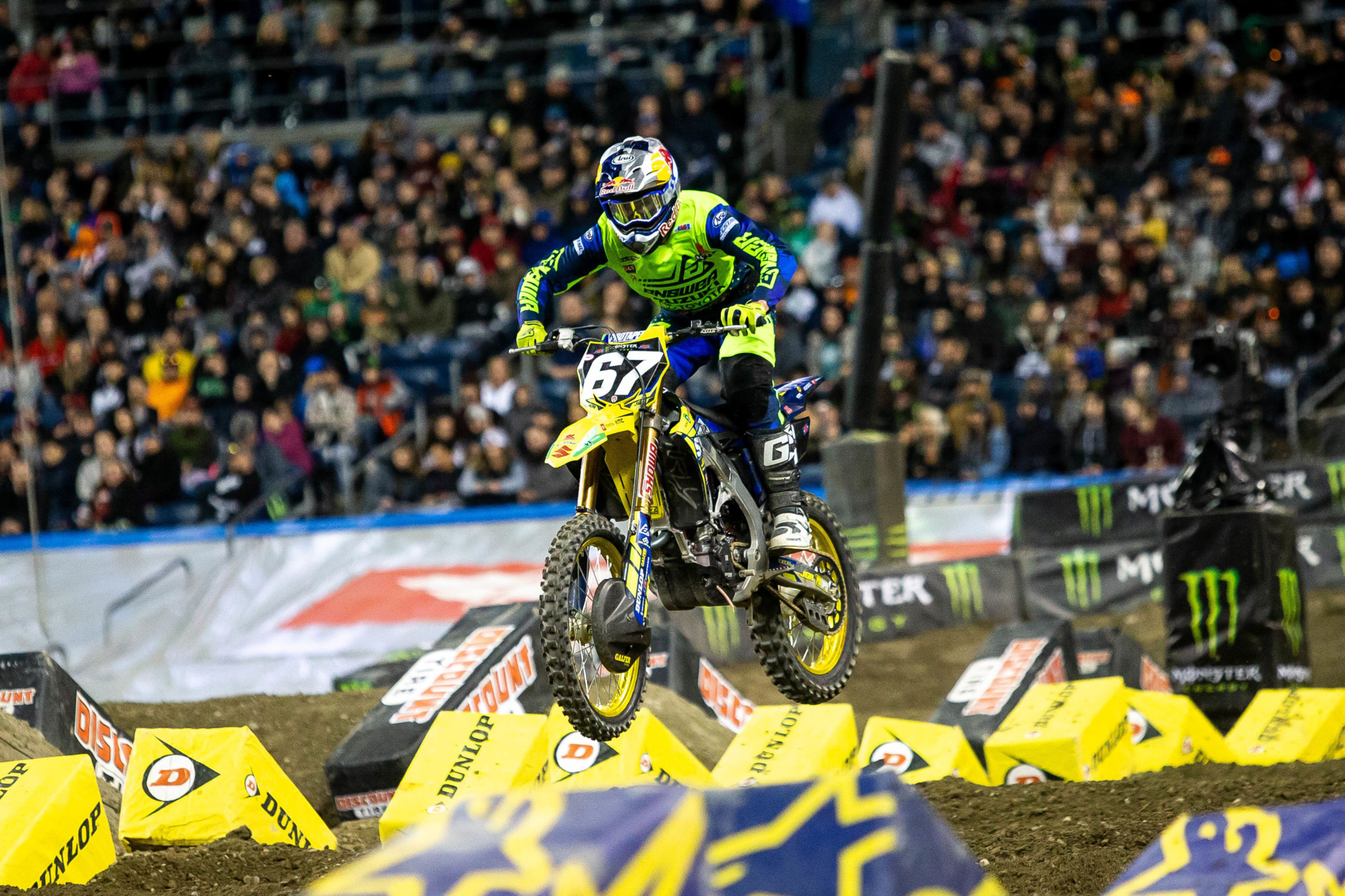 Enzo Lopes (#67) jumps through the treacherous whoops section on his RM-Z250 - Seattle Supercross