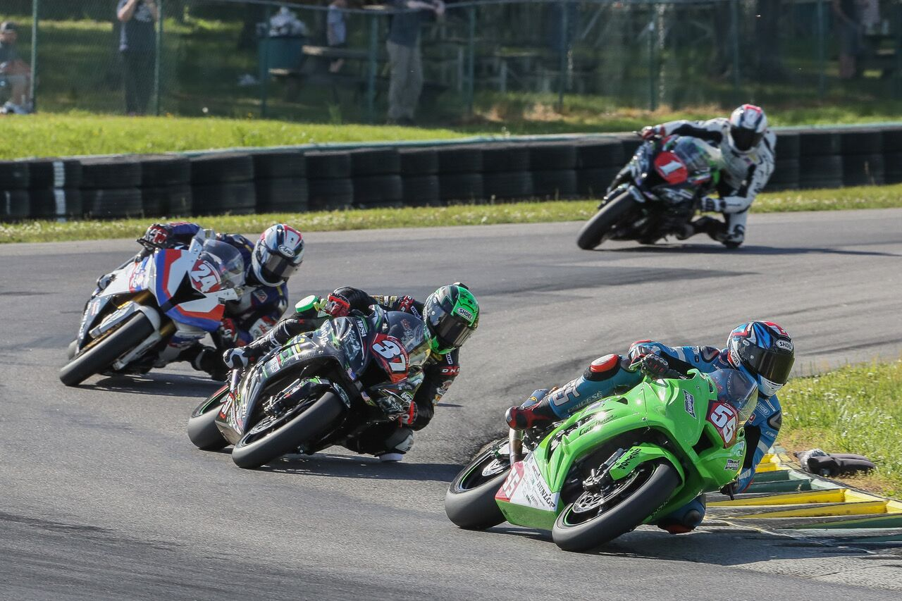 Michael Gilbert (55) held off Stefano Mesa (37), Travis Wyman (24) and Andrew Lee (1) to win the Stock 1000 race at VIRginia International Raceway