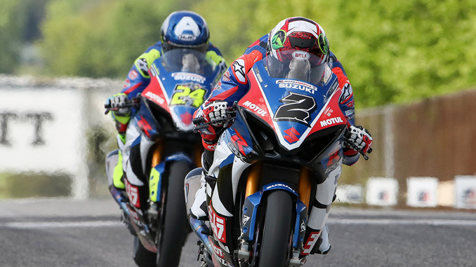 Yoshimura Suzuki's Josh Herrin (#2) leads teammate Toni Elias (#24) on his way to an eventual win in Sunday's MotoAmerica Superbike action at Road America
