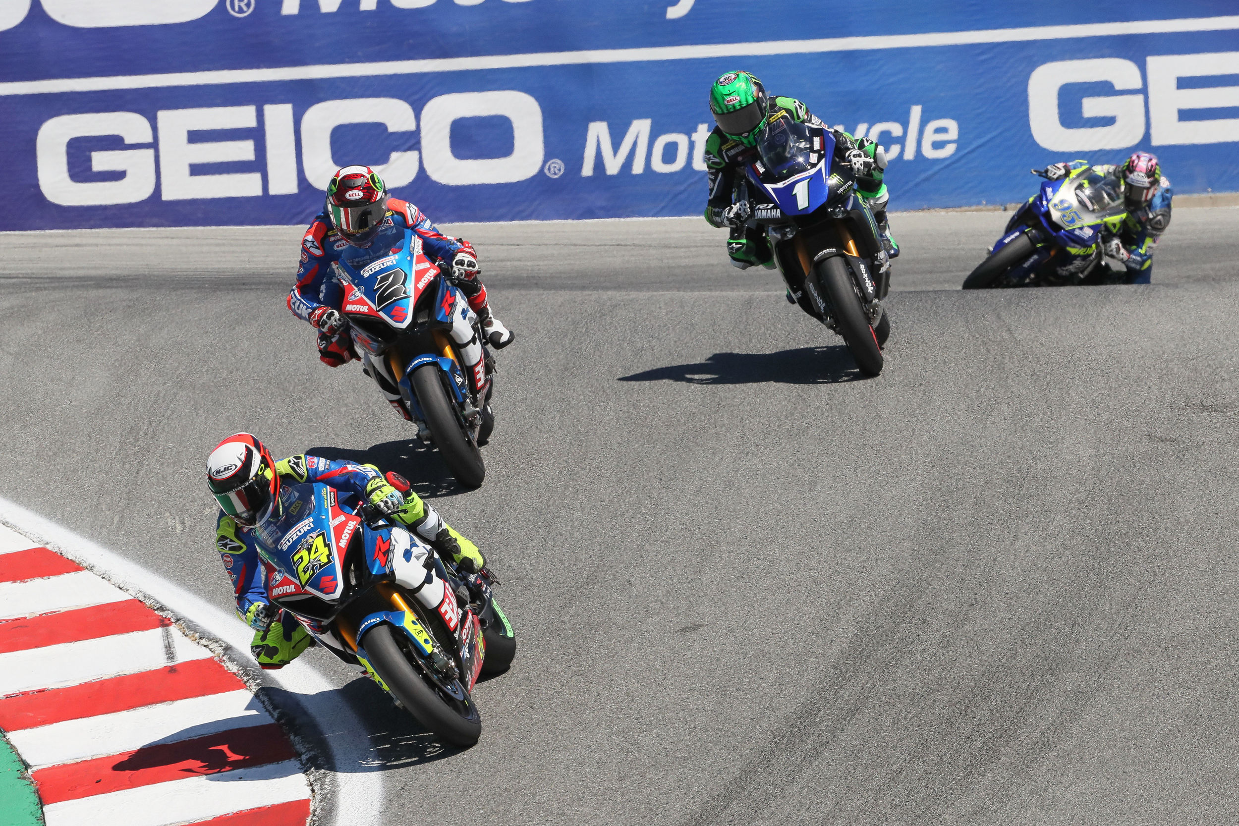 Toni Elias (#24) and Josh Herrin (#2) lead the pack down the infamous Laguna Seca Corkscrew