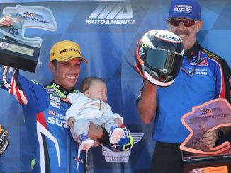 Yoshimura Suzuki's Toni Elias celebrated a race one victory with his son