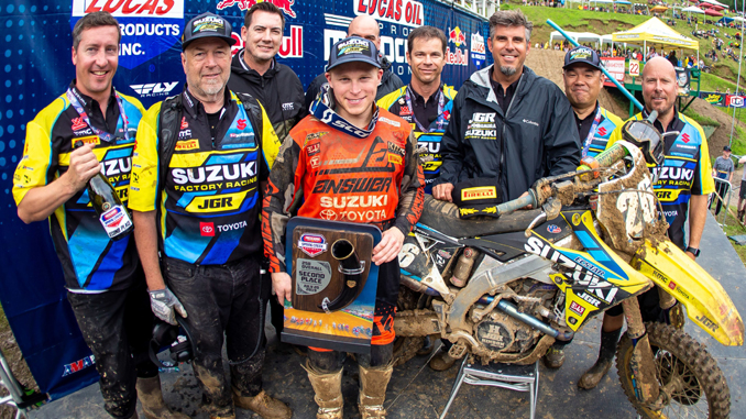 Alex Martin (#26) stands at the podium second overall with the JGRMX-Yoshimura Suzuki Factory Racing Team crew