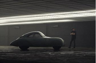 Jeff Zwart examines the 1939 Porsche Type 64 (Jack Schroeder © 2019 Courtesy of RM Sotheby's) Monterey
