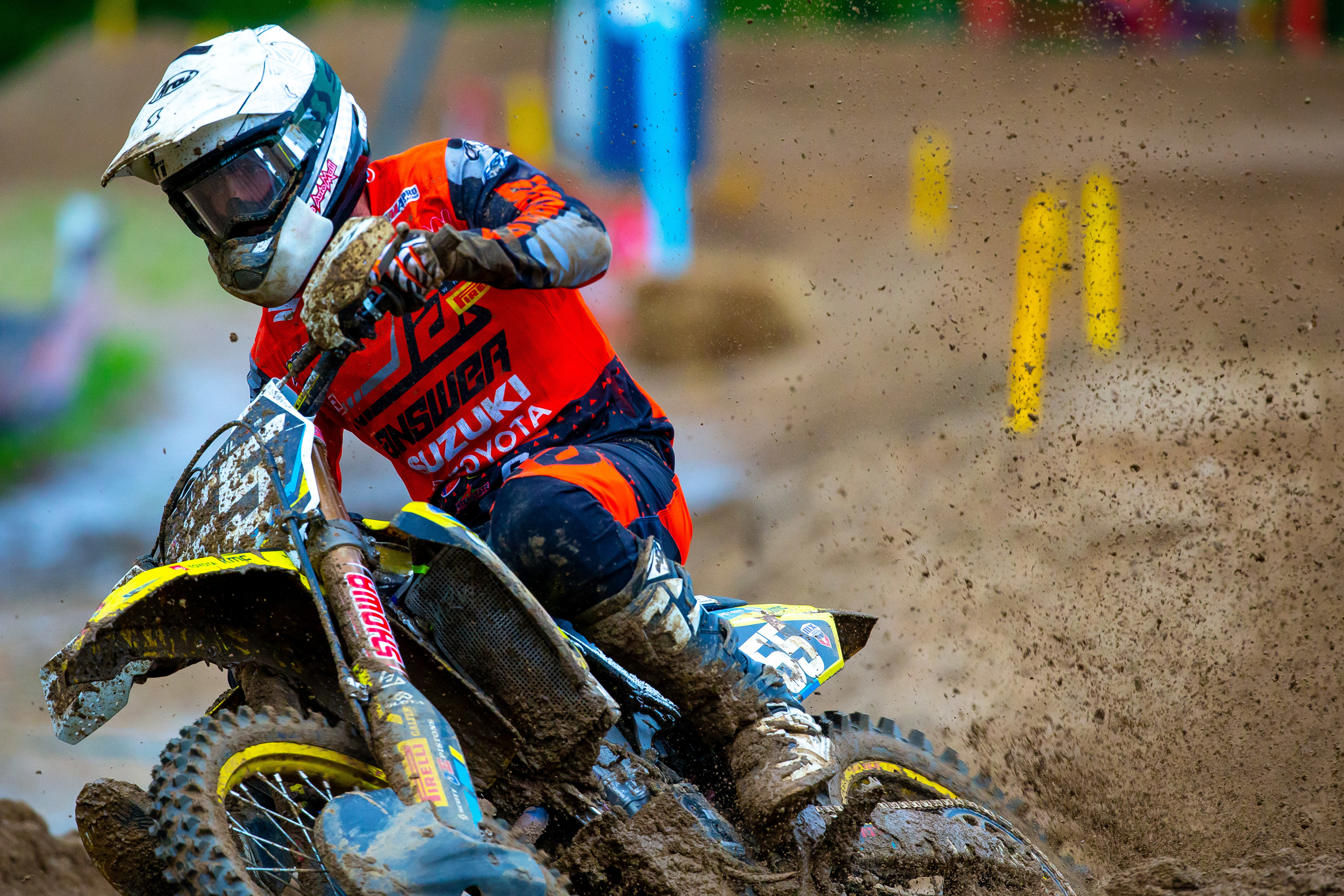 Kyle Peters (#55) pushes through the rough Millville conditions on his RM-Z250