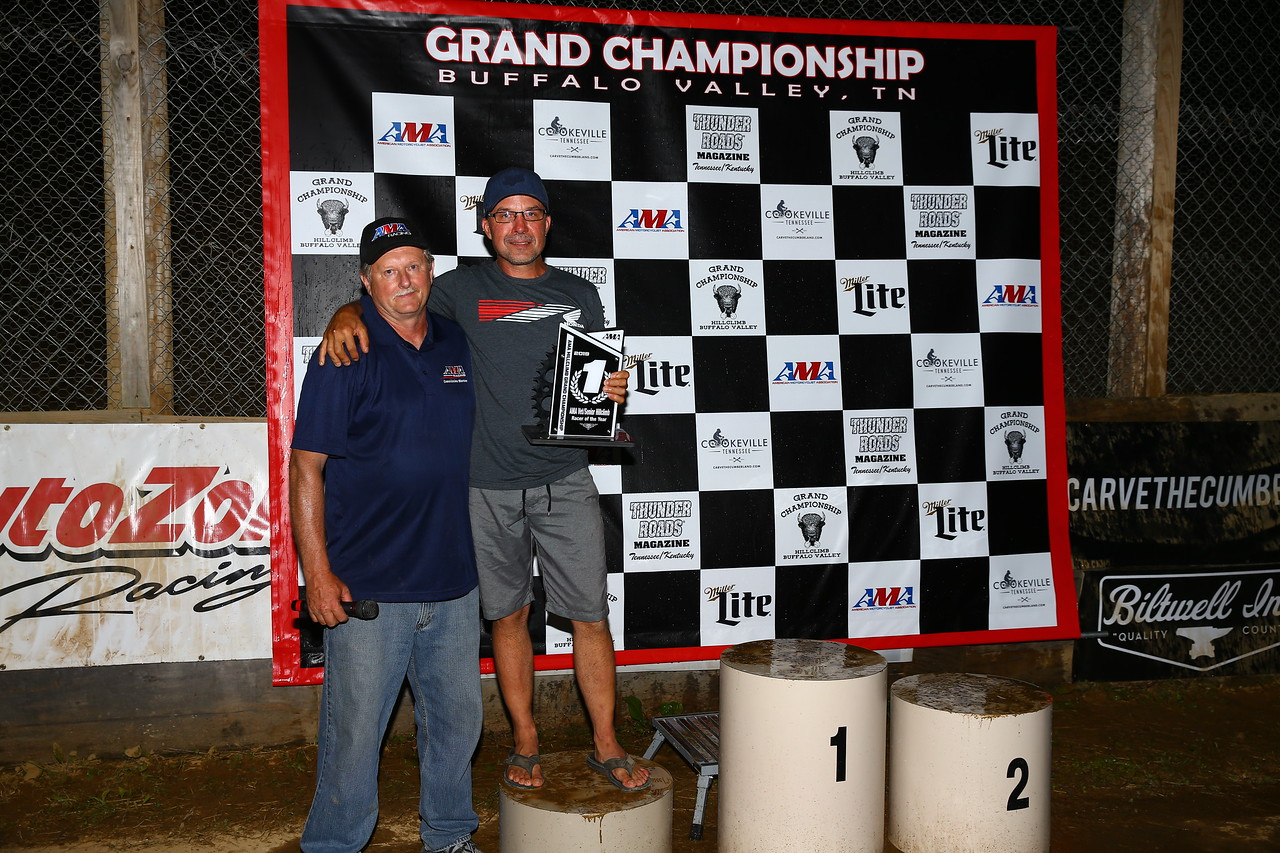 2019 AMA Vet/Senior Hillclimb Racer of the Year Mike Wood (right) receives his award from AMA Track Racing Commission Member Mike Bronk. (Credit: Joe Hansen)