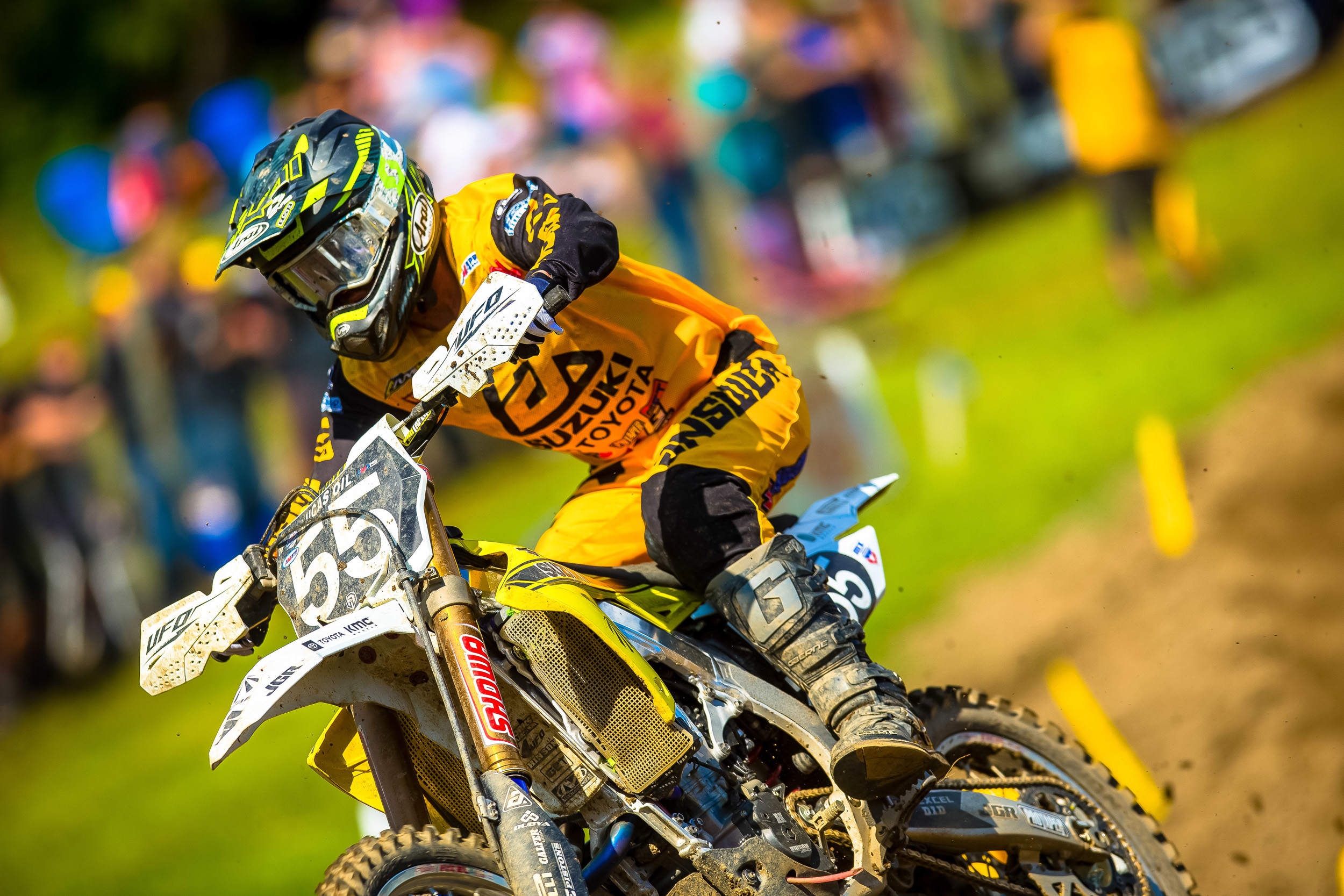 Kyle Peters (#55) illuminates the track with his historically-inspired wrapped RM-Z250 and all-yellow gear