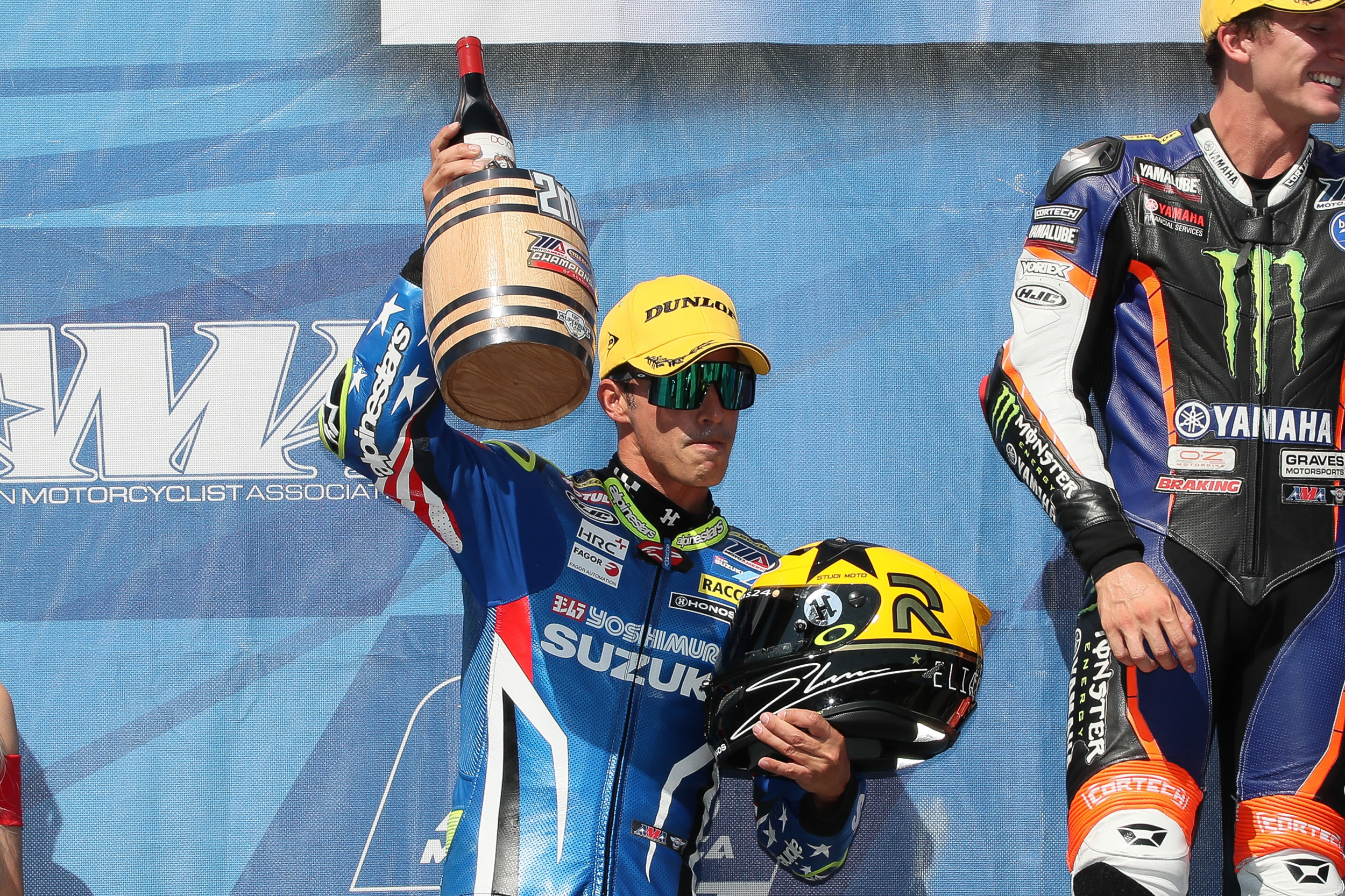 Toni Elias (#24) celebrates second place on the podium with Sonoma's wine-inspired trophy