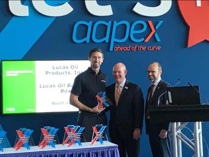 191118 Lucas Oil SVP of Sales Morgan Lucas receives the Environmental Impact Best Packaging Award at AAPEX 2019 in Las Vegas