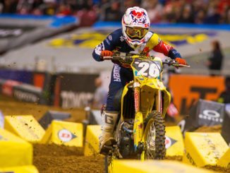 Alex Martin (#26) charges through the whoops on his RM-Z250 during the main [678]