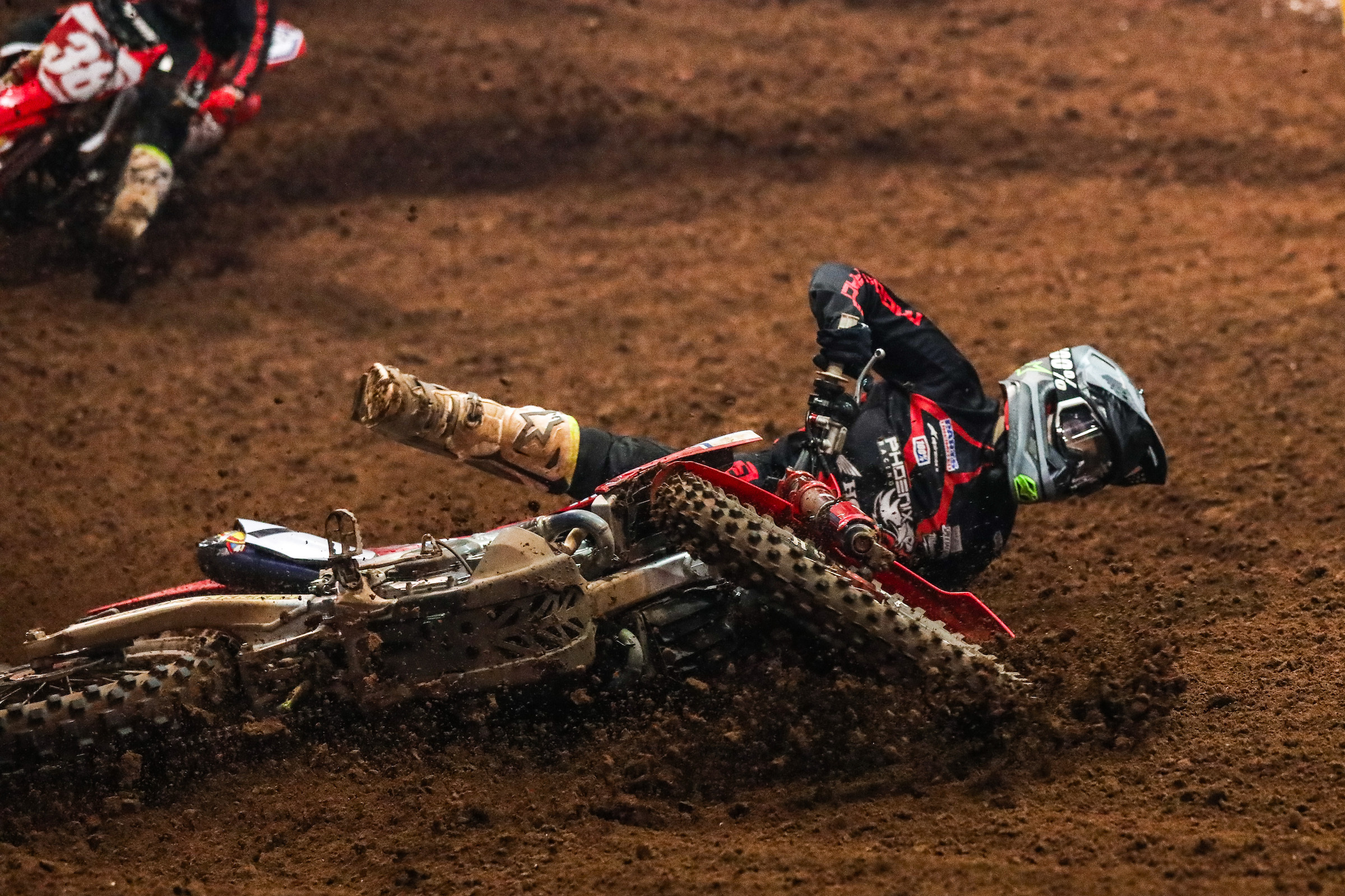 Phoenix Racing Honda Team Rider, Jace Owen, loses the lead in the 450 Pro Main on Saturday night after going down on the track. (Photo- Jack Jaxson)