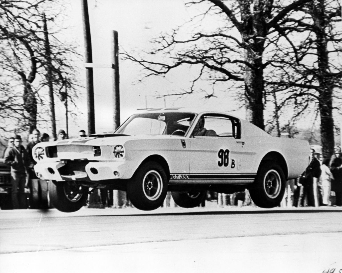 Ken Miles piloting Shelby 5R002 with all four wheels off the ground in February 1965