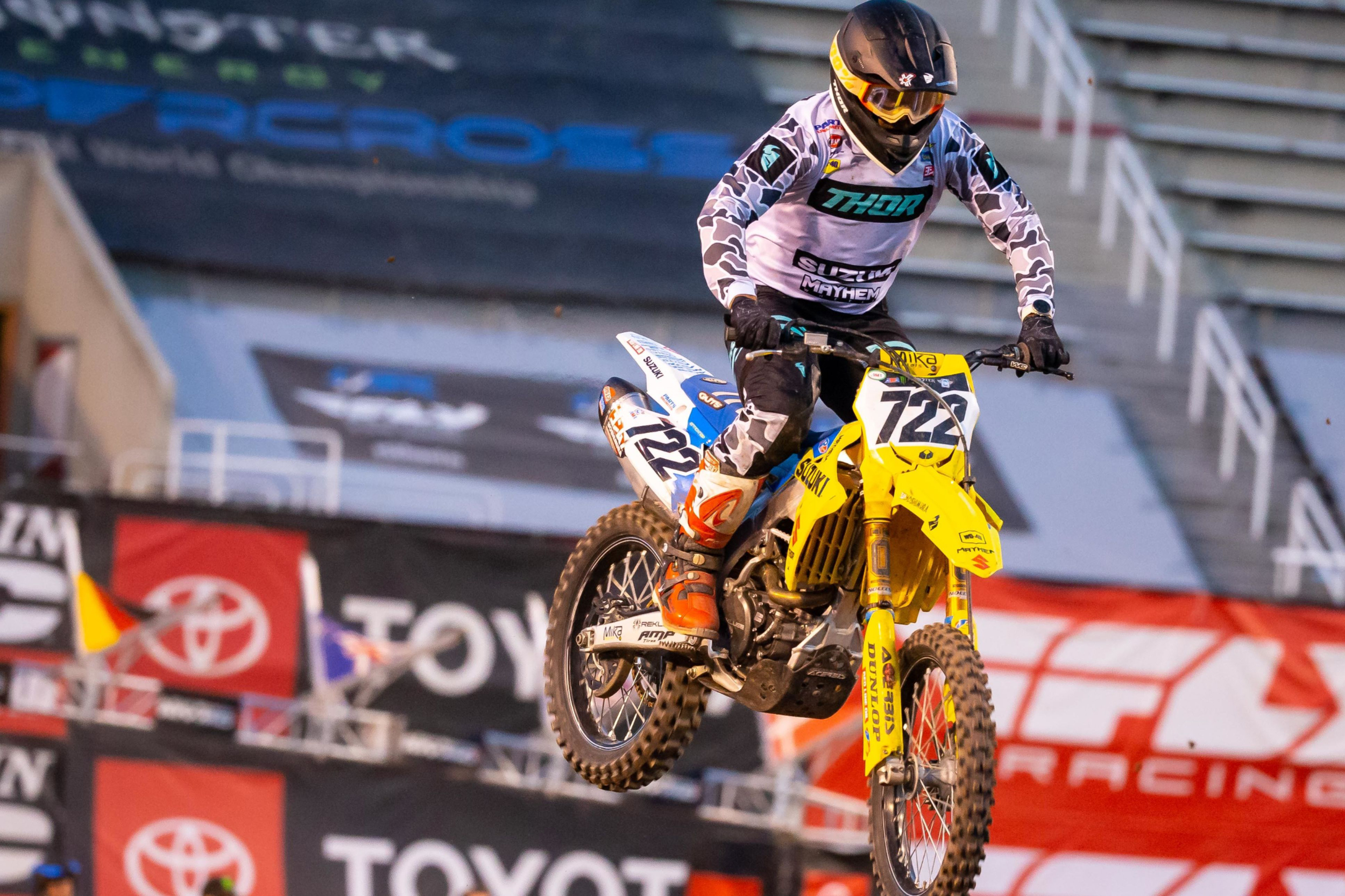 Adam Enticknap (#722) soars over the Salt Lake City track on his Suzuki RM-Z450