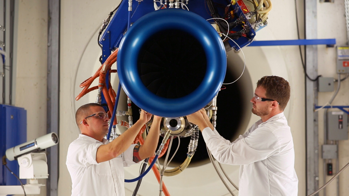 Honda Aero Inc. associates testing the HF120 GE/Honda Aero light jet engine.