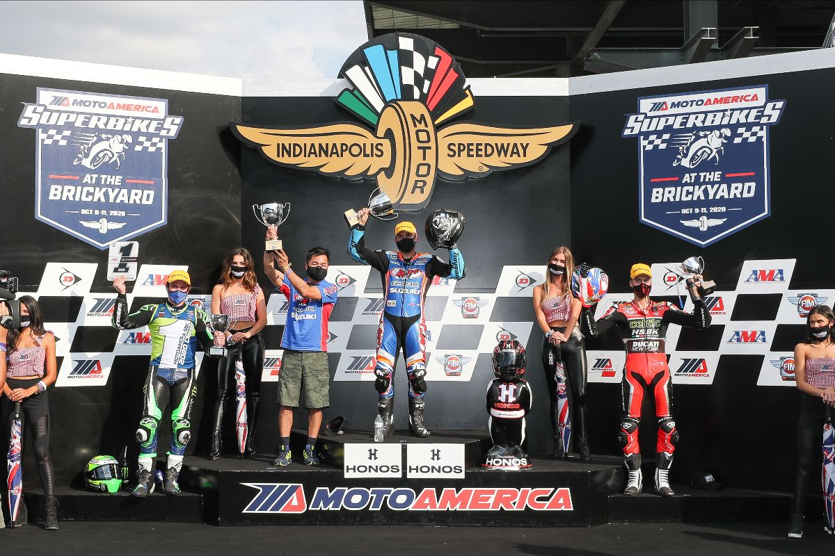 201012 (From left to right) Beaubier, Fong and Zanetti celebrate their race three finishes on The Brickyard podium
