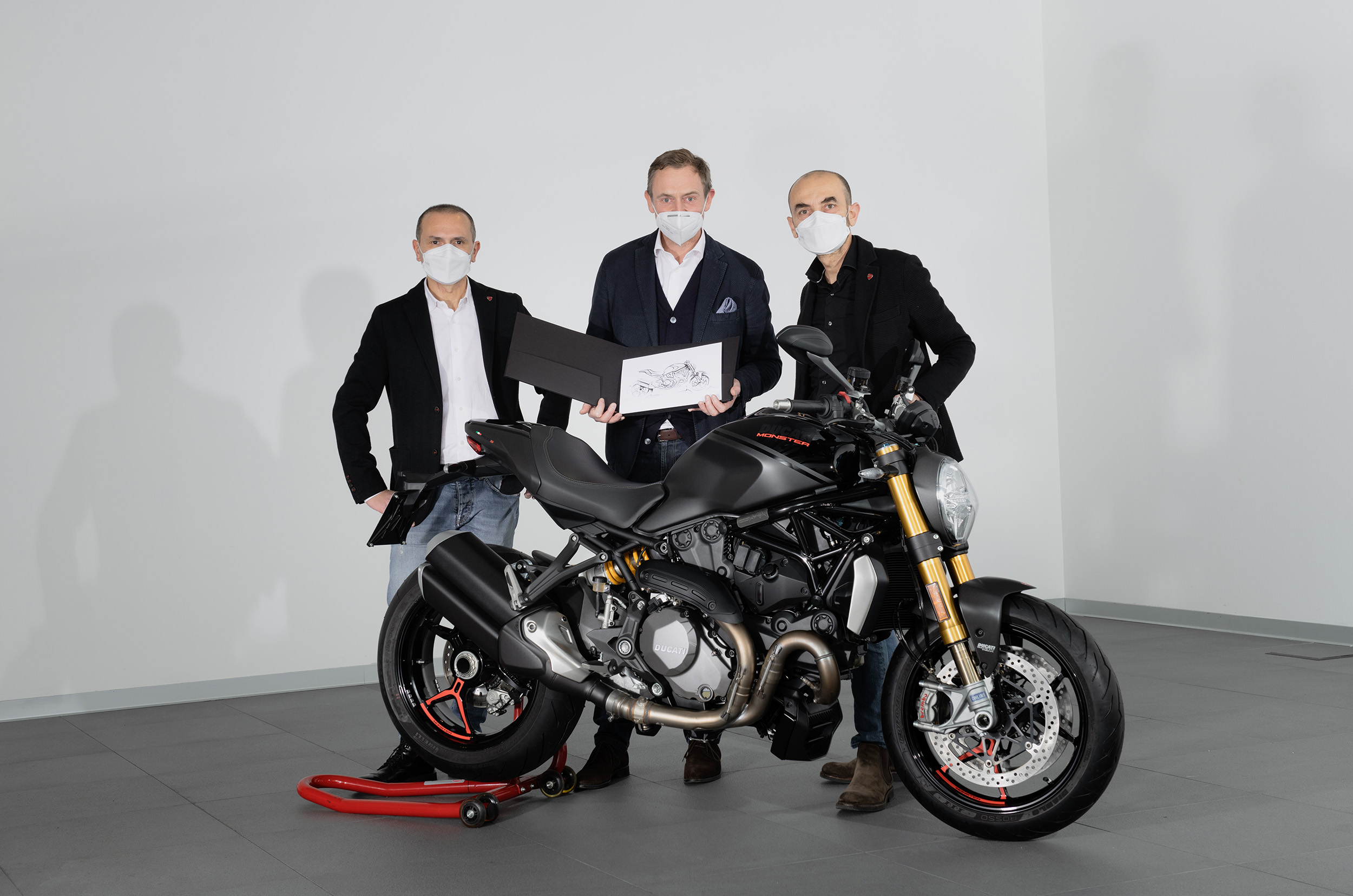 C. Domenicali (CEO Ducati) - A.Ferraresi (Ducati Design Centre Director) handing over the 350,000th Monster to S. De Rose