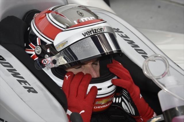 Will Power adjust his helmet with Racing Optics' tear-offs on visors