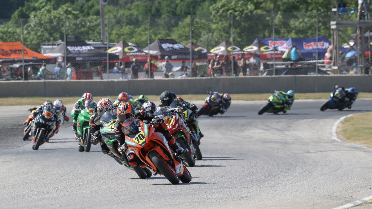 120613 The SportbikeTrackGear.com Junior Cup race was a war with Tyler Scott (70) coming out on top