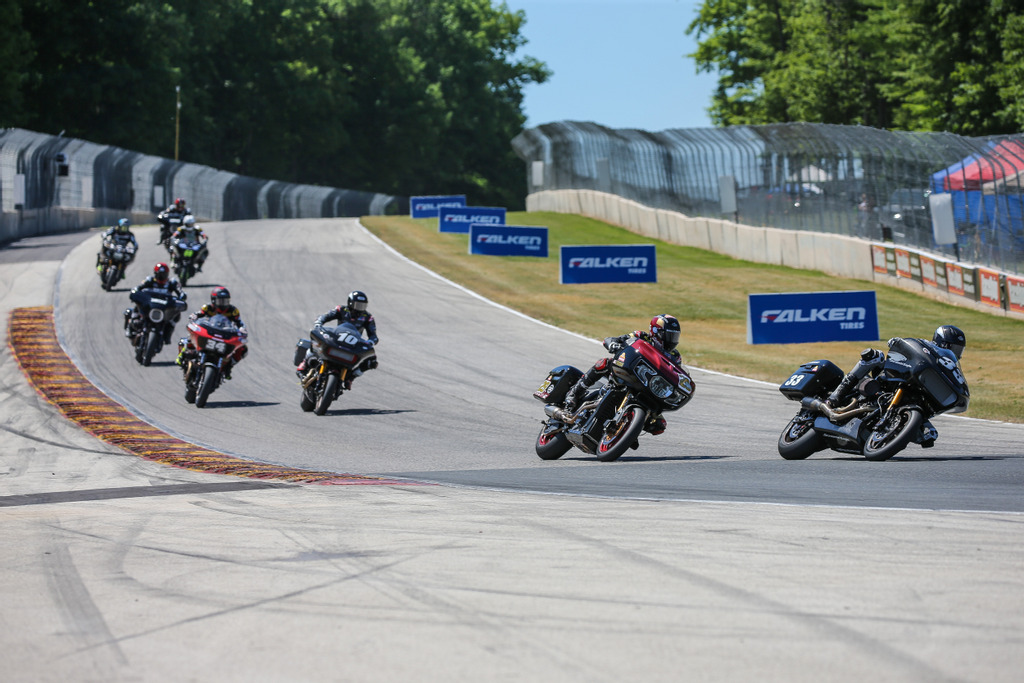 Kyle Wyman (#33) leads Tyler O'Hara (#29), Travis Wyman (#10) and the rest of the King of the Baggers field into Turn 5 at Road America in the opening stages of the race. Photo Credit- Brian J. Nelson