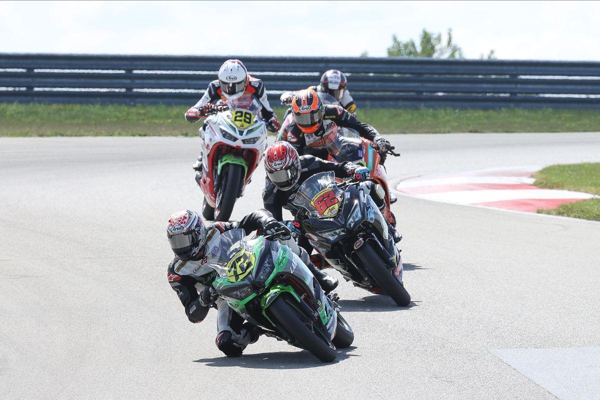210815 Ben Gloddy (72) leads Joe LiMandri Jr. (62) and Tyler Scott (hidden) en route to winning the SportbikeTrackGear.com Junior Cup race