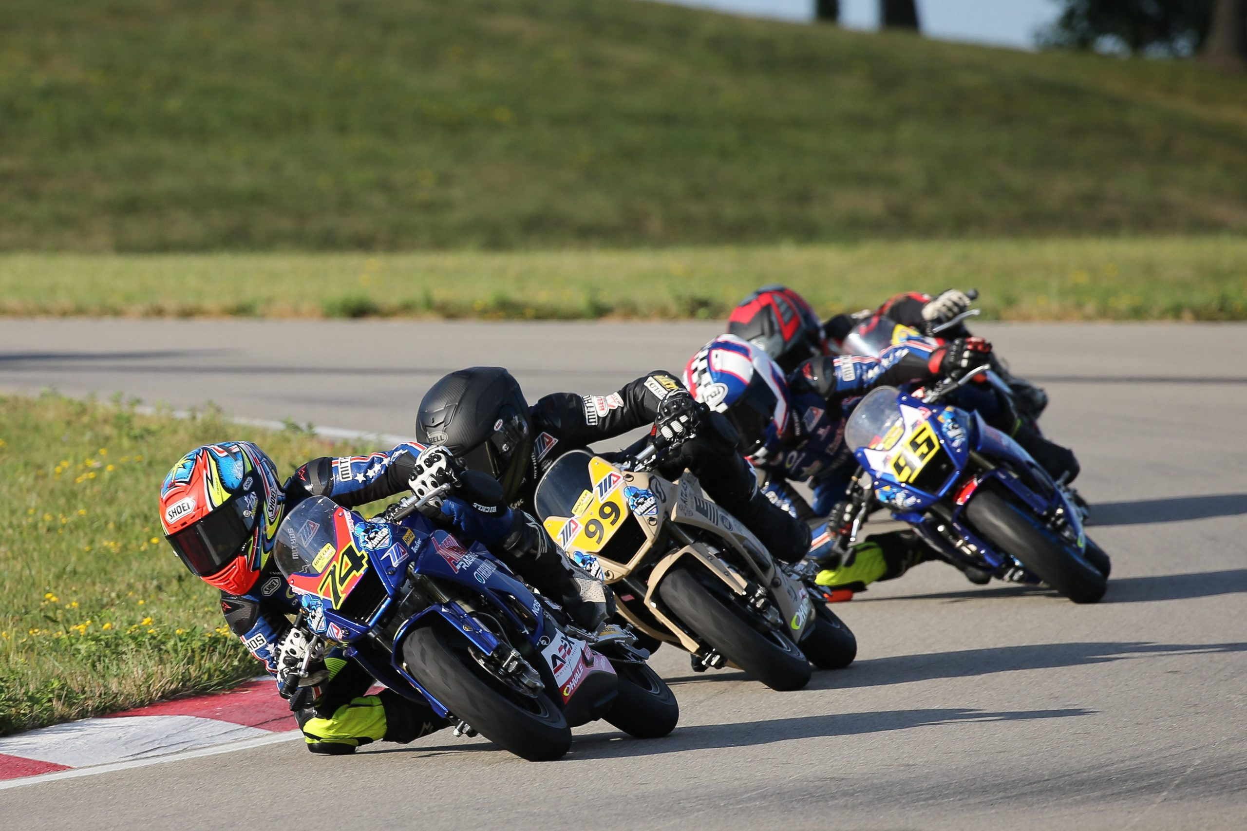 210815 Kensei Matsudaira (74) leads Jesse James Shedden (99) en route to victory in the Mini Cup