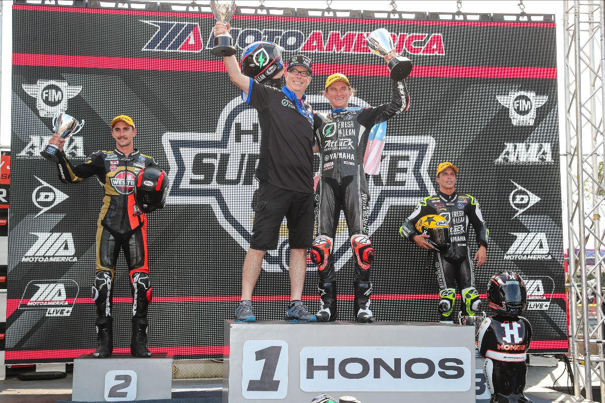 210912 (From left to right) Mathew Scholtz, Darin Marshal, Jake Gagne and Toni Elias celebrate on the NJMP podium on Saturday