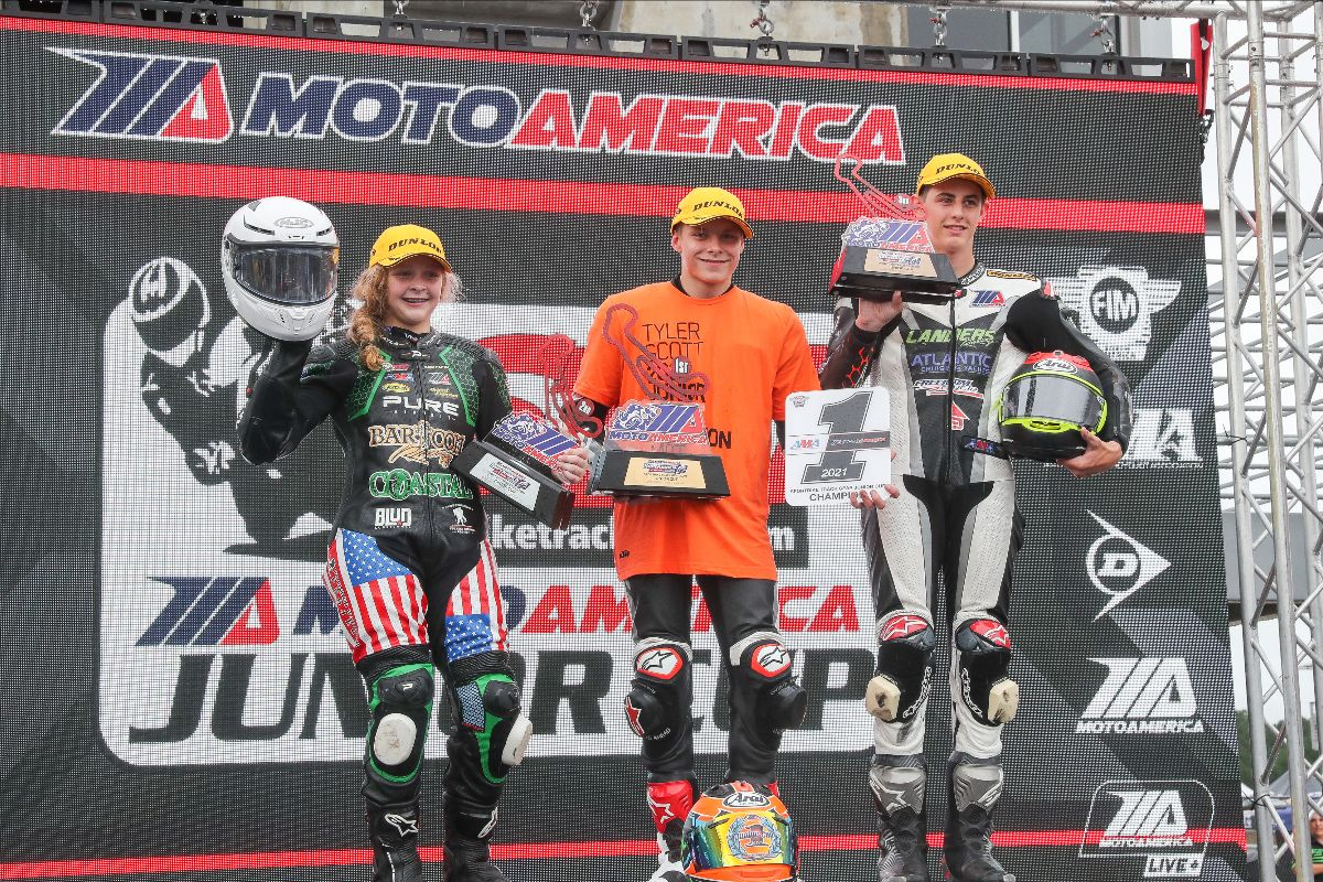 210919 (From left to right) Kayla Yaakov, Tyler Scott and Ben Gloddy celebrate on the Barber podium