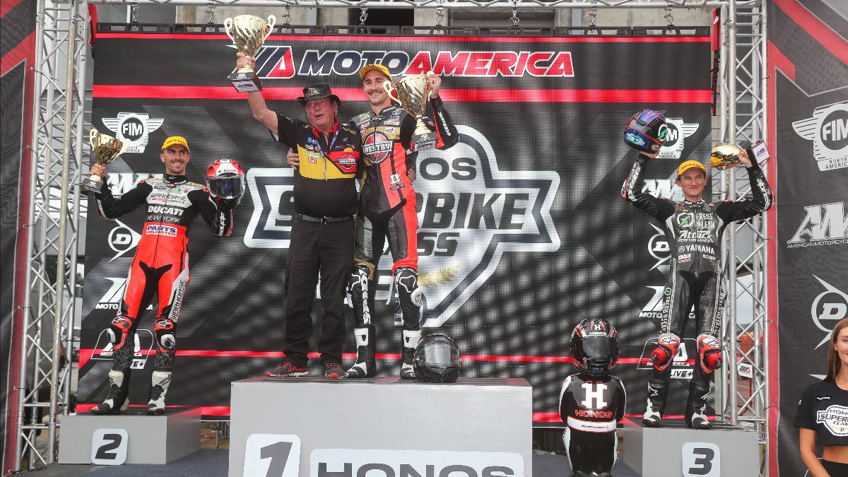 210920 Mathew Scholtz celebrates his victory with team owner Trig Westby, Loris Baz and Jake Gagne